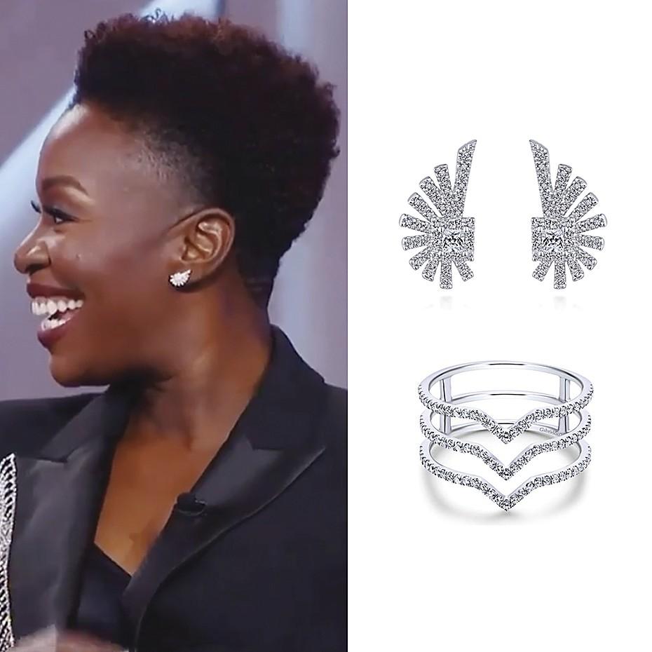 January 2021 Actress Folake Olowofoyeku wearing Gabriel & Co.'s 14K White Gold Layered Diamond Chevron Wide Band Ring (style#LR50897W45JJ) and 14K White Gold Diamond Studs (style# EG13390W45JJ)