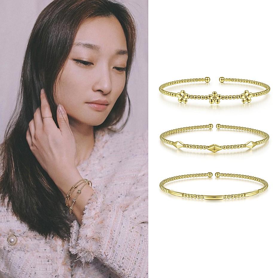 March 2021 Qianwen Chen sharing her Gabriel & Co.'s gold Bujukan cuffs on Instagram