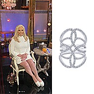 January 2021 Real Housewives of Orange County star Shannon Beador wearing Gabriel & Co.'s Wide Band Twisted Wrap Ring (style#LR50652W45JJ) & 18K White Gold Diamond Pave Oval Sunburst Statement Ring (style#LR51398W84JJ)