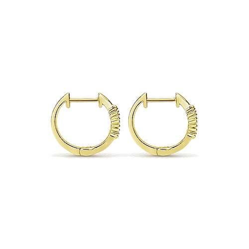 14k Yellow Gold Bujukan Huggie Earrings angle 2