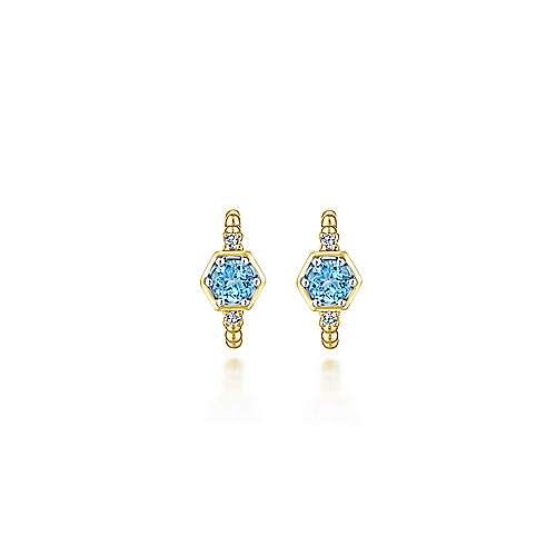 14k Yellow Gold Diamond & Swiss Blue Topaz Huggie Earrings angle 3