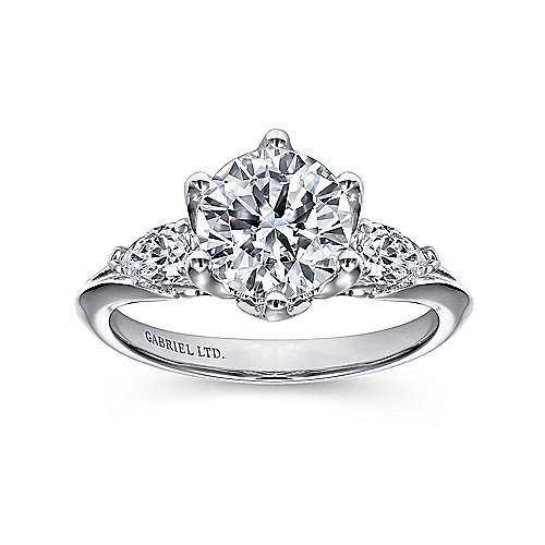 bridal engagement kindlers shank stunning jewelers is slim leading features studded amavida with center scalloped round stone ring rings encircled that diamonds this by up to a